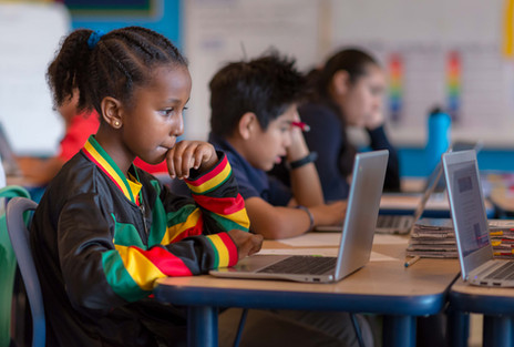 Charter School Girl on Laptop in Classroom