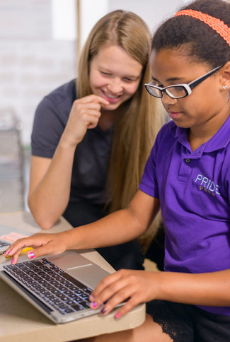 Charter School Black Student on Laptop with Teacher