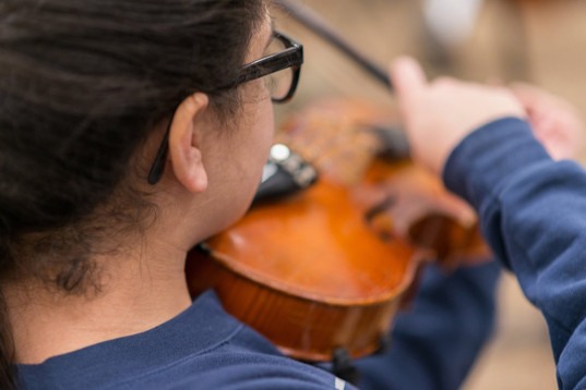 Girl Playing Violin at Charter School