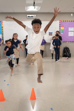 Charter School Black Boy Dancing and Leaping