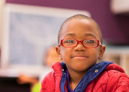 Portrait of Black Boy in Charter School