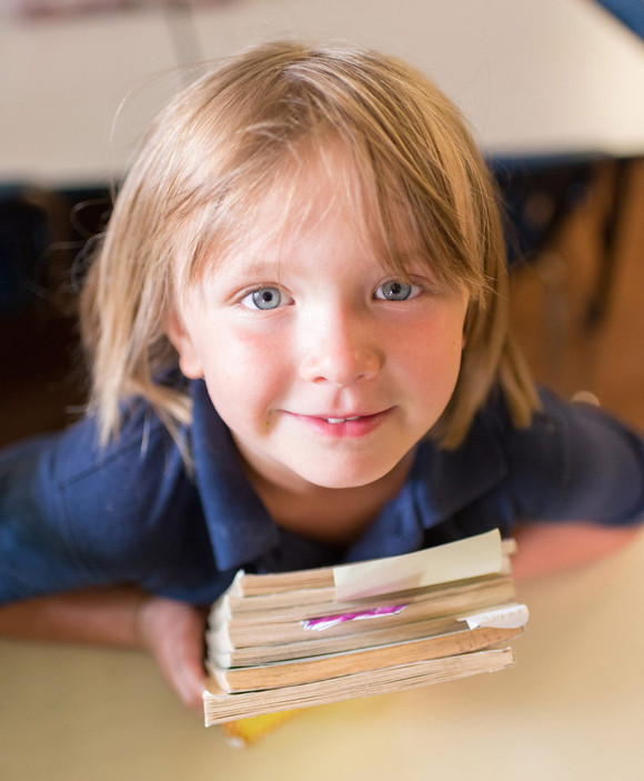 Elementary School Girl Student Looking Up with Books