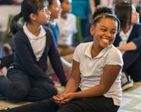 Black Girl Smiling in Class