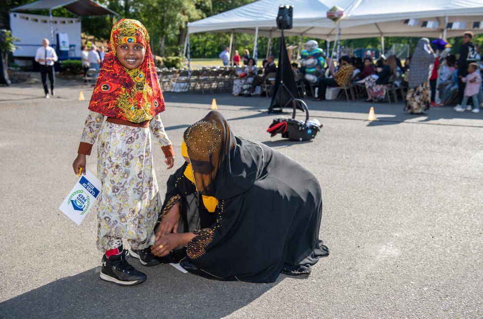 Rainier Prep Charter School Graduation Mother Tying Shoes