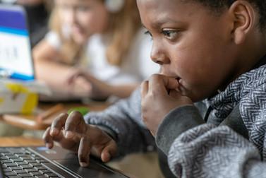 Black Boy on Laptop in Charter School