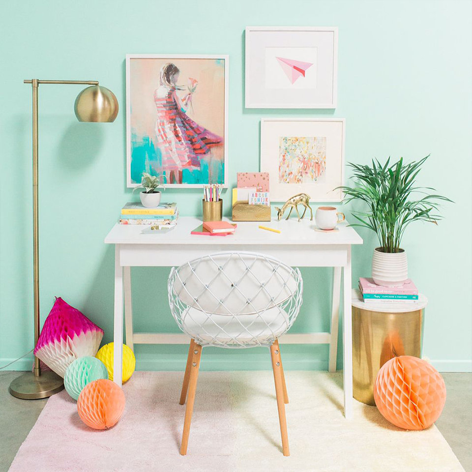 Pastel interior work station featuring lifestyle products from Oh Joy!