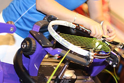 restringing tennis racquets at Kooyong Pro Shop