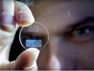 'Five-dimensional' glass discs can store data for up to 13.8 billion years