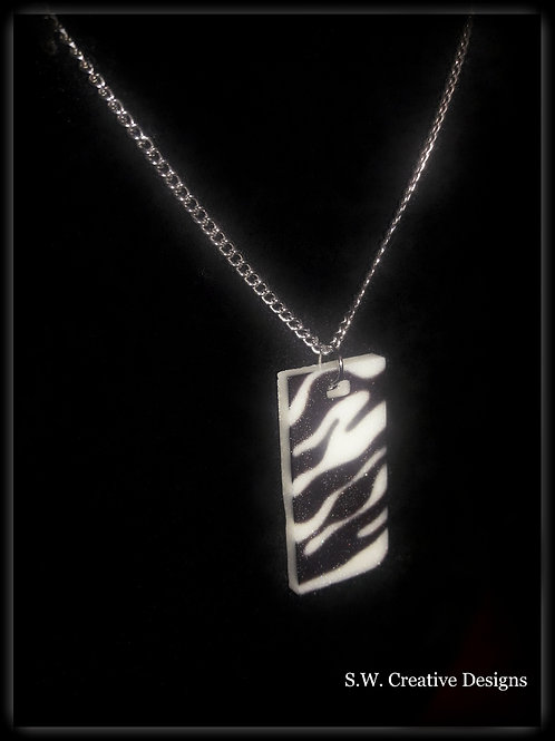 S.W. Zebra Print Glow in the Dark Pendant and Necklace