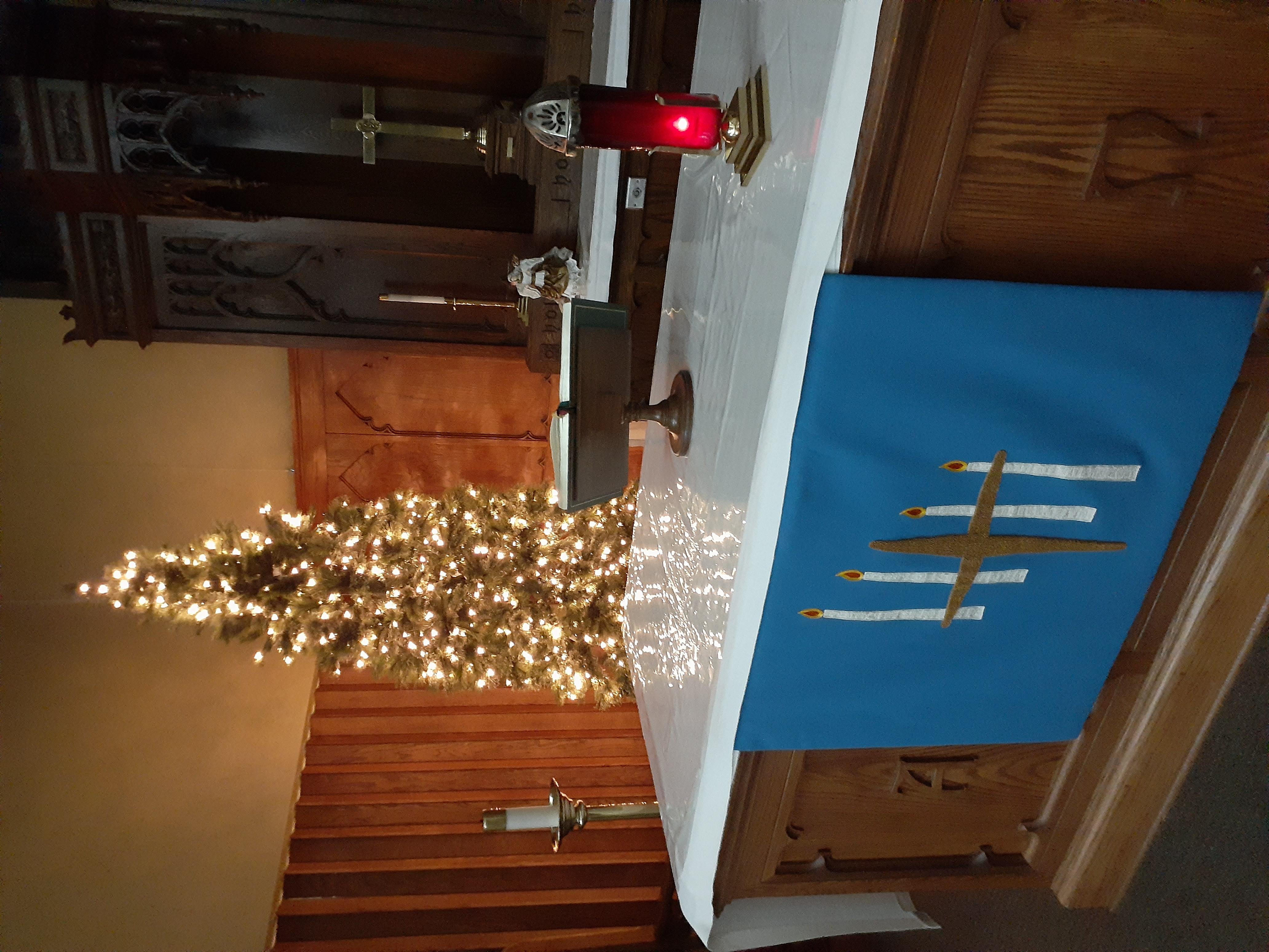 lighted tree at altar