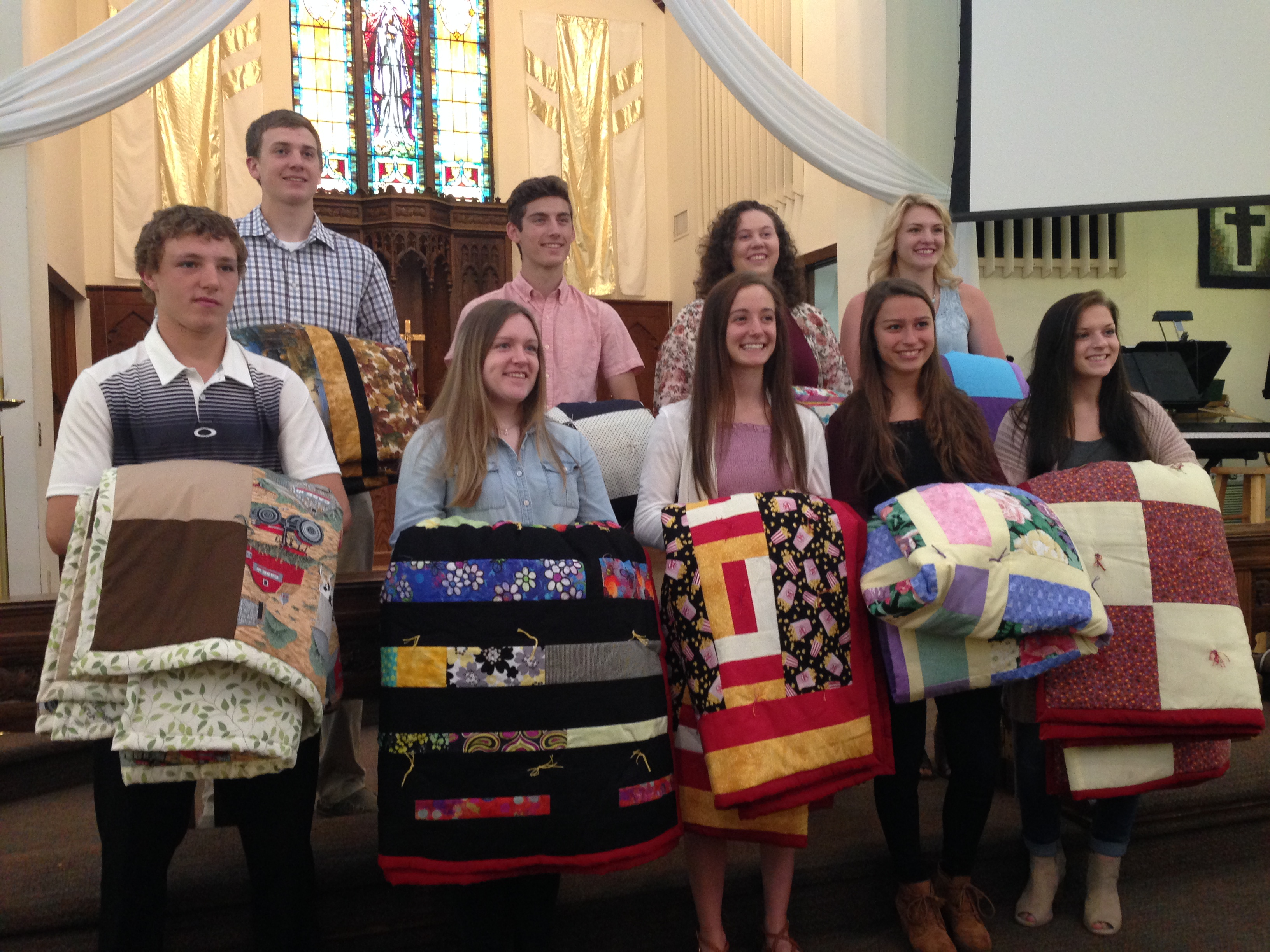 grads with quilts