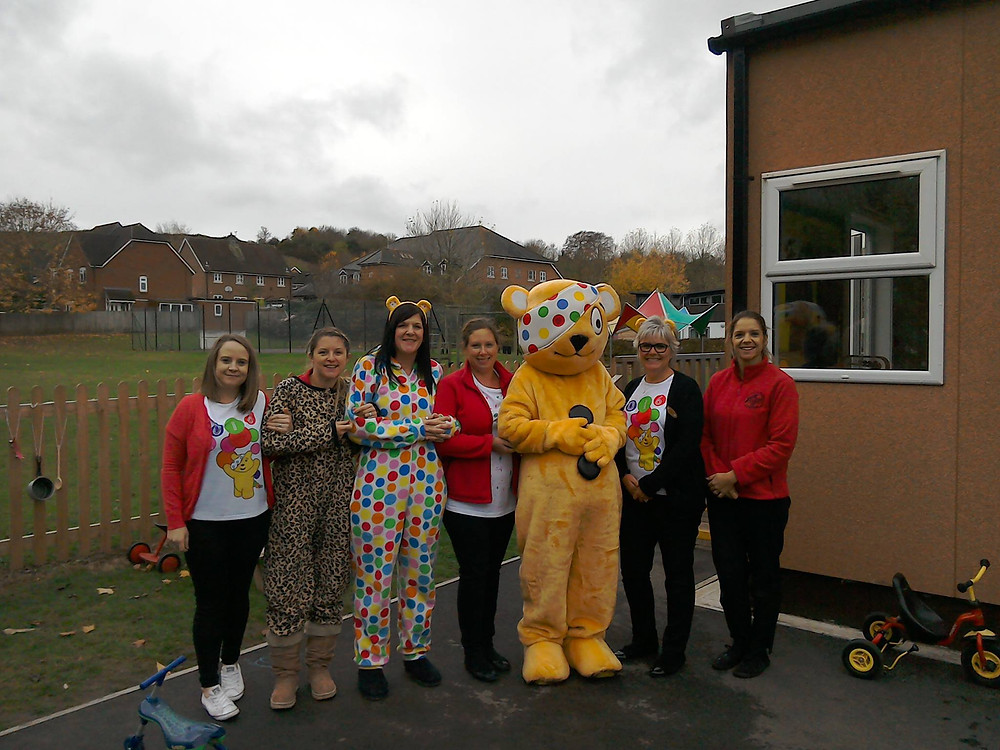 Staff get a cuddle with Pudsey