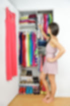 Home closet - woman choosing her fashion