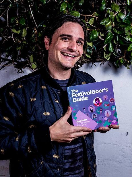 Festival Guy With FestivalGoer's Guide.jpg