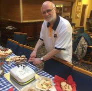 CHS_John Dawson cut cake_03-03-2019.jpg