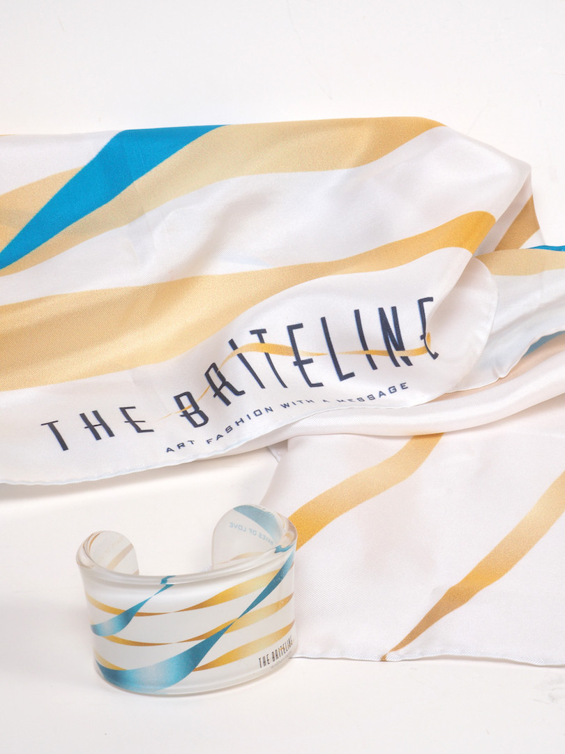 """""""Rays of Light, Waves of Love"""" Silk scarf and plexiglass cuff bracelet. Especially designed for FASHION for LIFE initiative - Portion of the sales benefit the cause of the palliative care Unit """"Jeny Karezi"""" of the Medical School, University of Athens."""