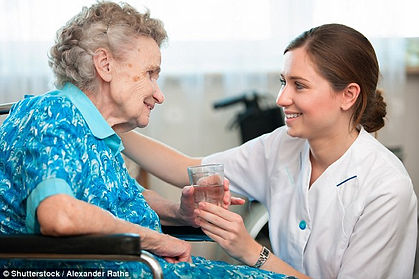 elderly lady with her friendly carer