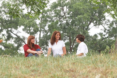 Kids and I sitting on hill.jpeg