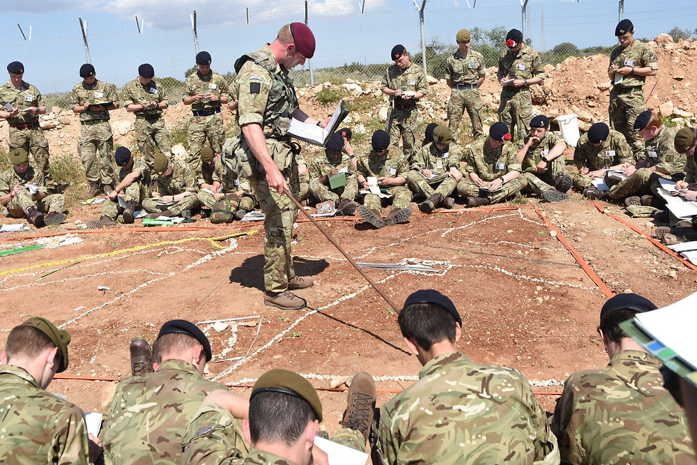 Officer Cadets receive a set of Company Deliberate Attack Orders, during the PRACTAC.