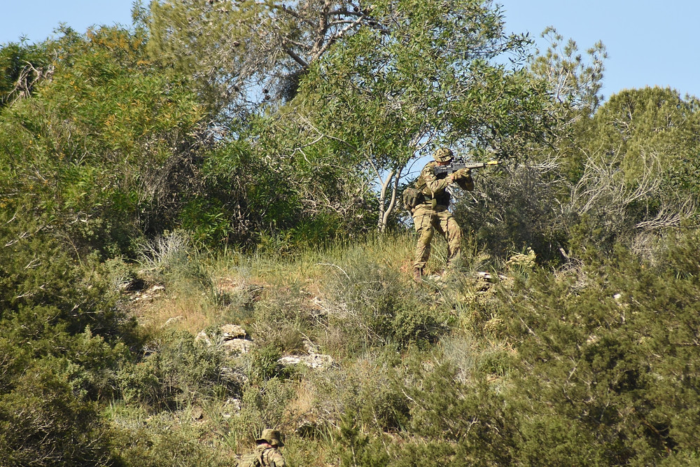 An Officer Cadet fighting through the Cypriot terrain