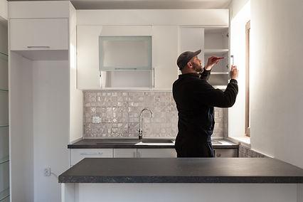 Carpenter working on new kitchen. Handym