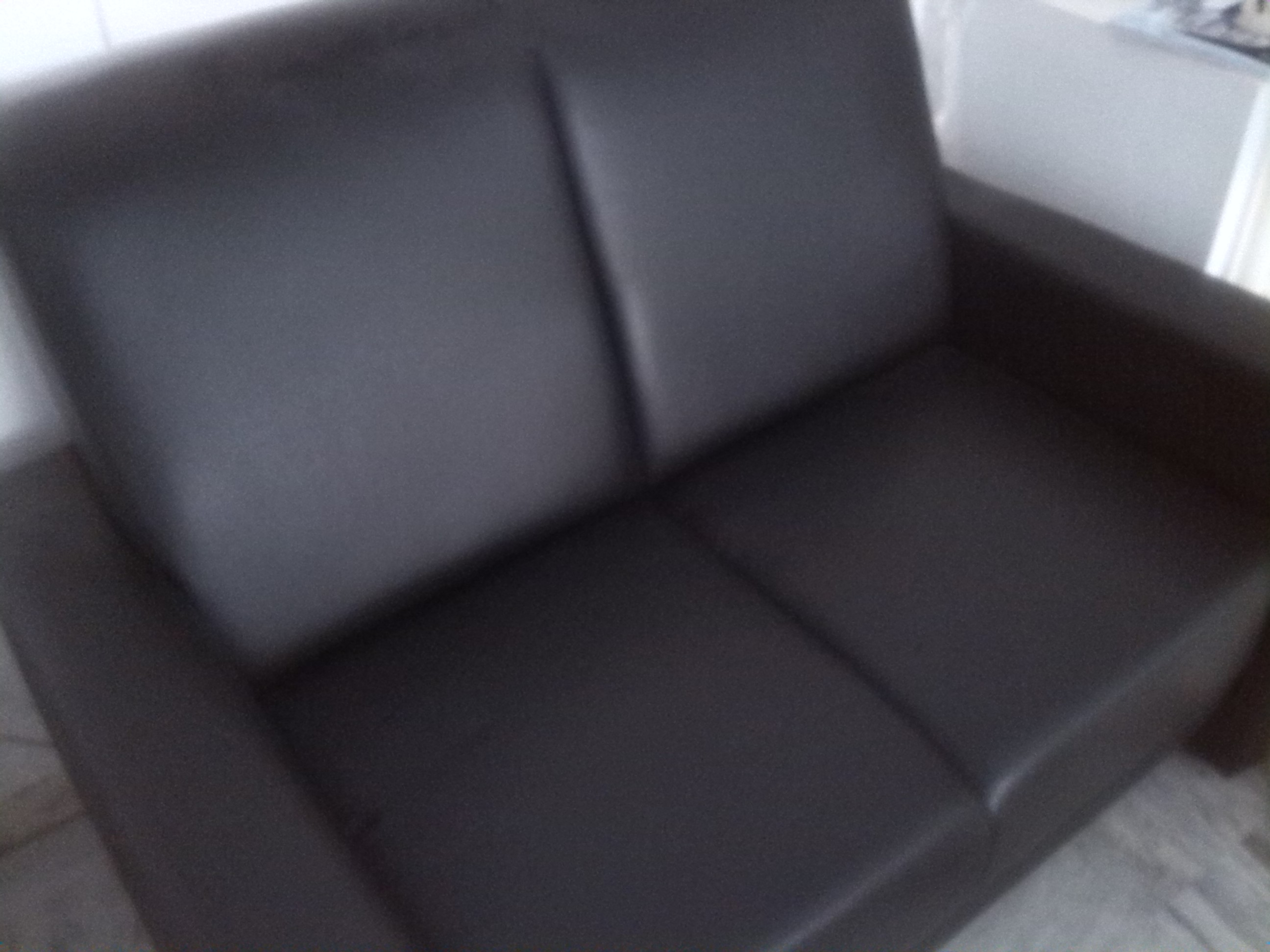 Black 2 seater leather look sofa