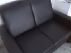 Black 2 seater leather look sofa