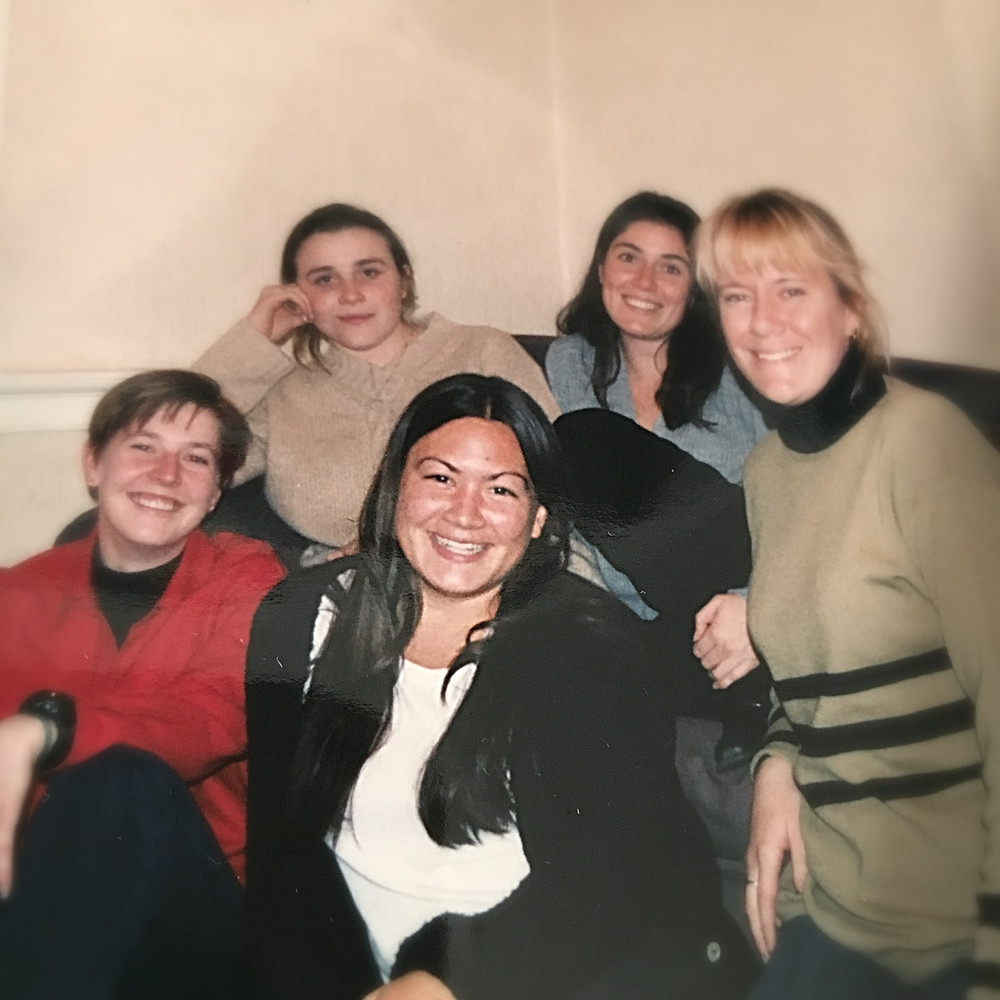 Girls in a group photo in Scotland, Erin is front center with huge smile