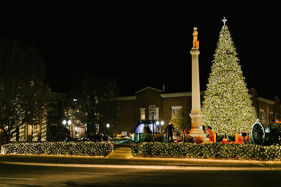 Downtown square all lit up for Christmas, with a big Christmas tree
