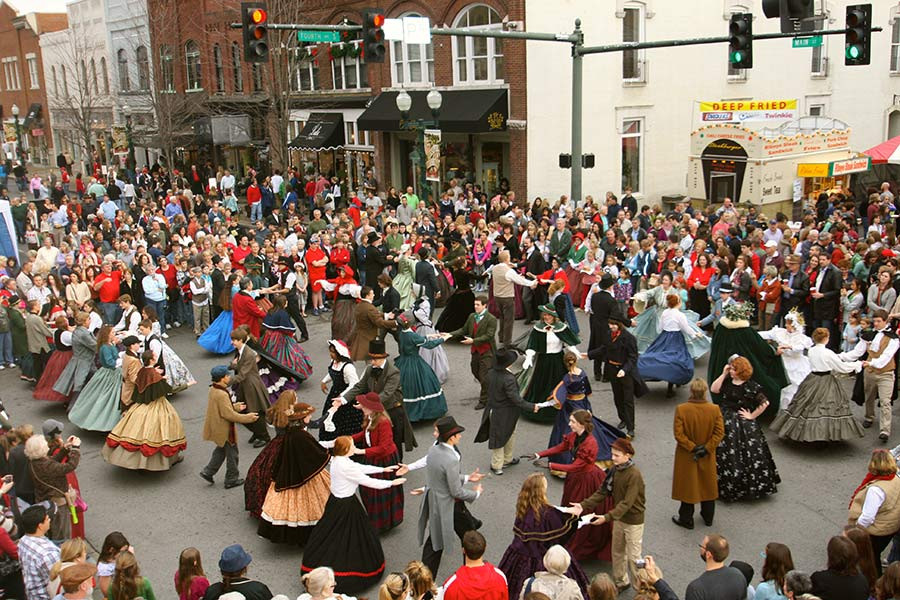 People dancing in the street in period costume