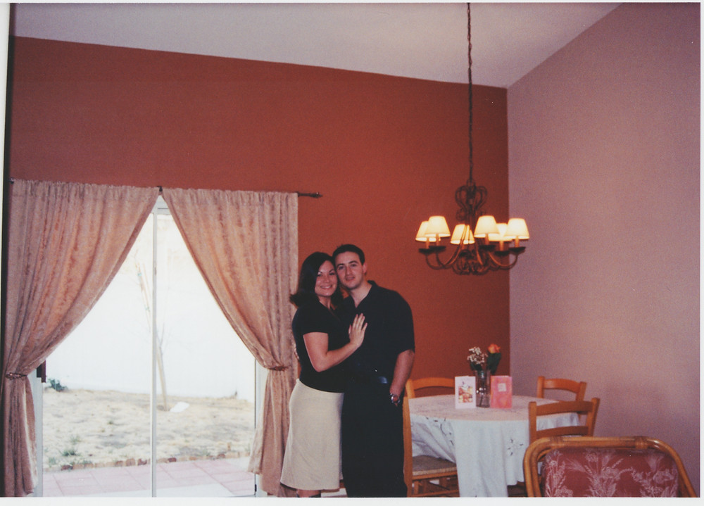 Us in our first home, cheesy pose.