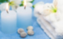 Spa bluish ccandle with white towels.jpg