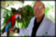 Dr. Michael Fulton posing with his macaw, Tabasco, outside his sports medicine facility named Medical Exercise Associates, located in Daytona Beach, Florida. Dr. Michael Fulton is an Orthopedic Surgeon who no longer performs surgery, rather he focuses on strength training exercises and protocols for the treatment of musculoskeletal injuries and medical fitness training.