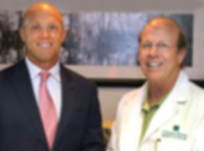 Dr. Brent Fulton (on the left) and Dr. Michael Fulton (on the right) posing at their Sports Medicine facility located in Daytona Breach, Florida.  Medical Exercise Associates is a sports medicine clinic and medical fitness center dedicated to health and wellness with a focus on prevention and rehabilitation techniques for people with medical conditions or athletes striving to enhance their performance.