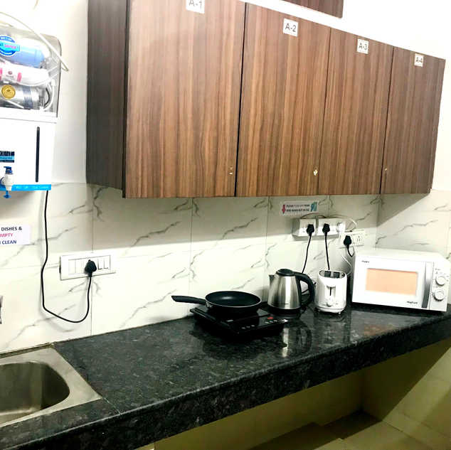 Fully Equipped Kitchen with Fridge, Water Purifier, Microwave, Toaster, Electric Kettle, Induction Stove