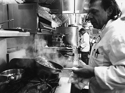 Chef Michael Ross in action cooking in the sauté station.