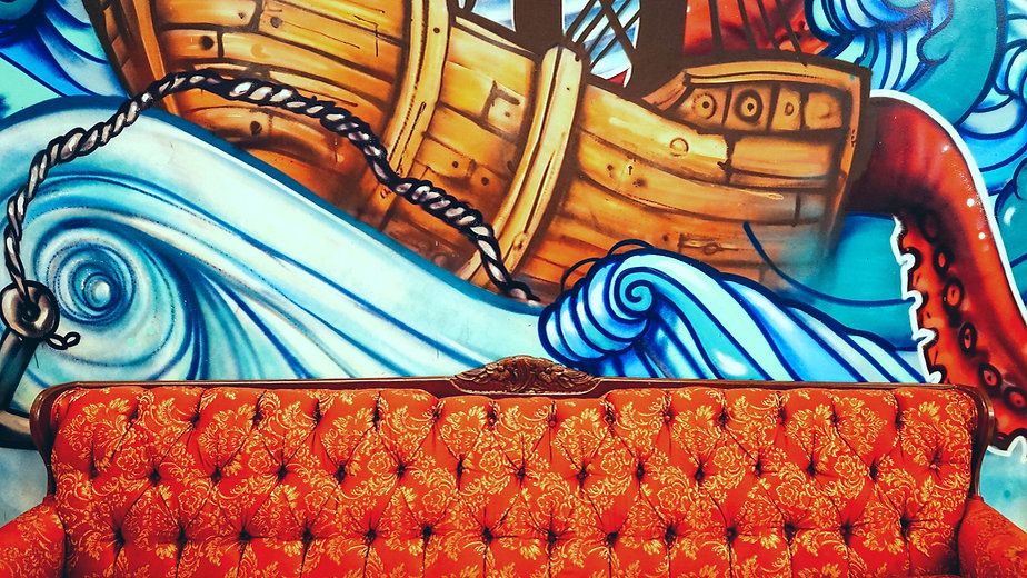Couch%20in%20front%20of%20boat%20mural_e