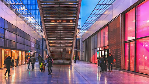 people%20walking%20on%20hallway%20between%20buildings_edited.jpg