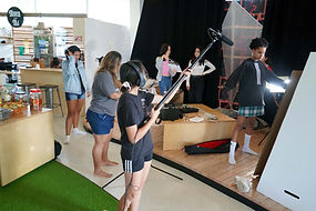 group of young women filming on a set