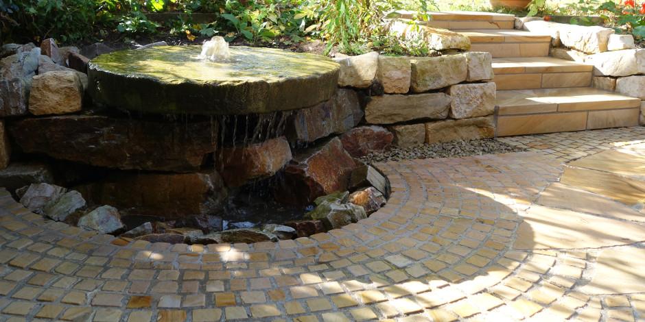 Brunnen Mühlstein