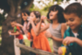Kids%20Blowing%20Bubbles_edited.jpg