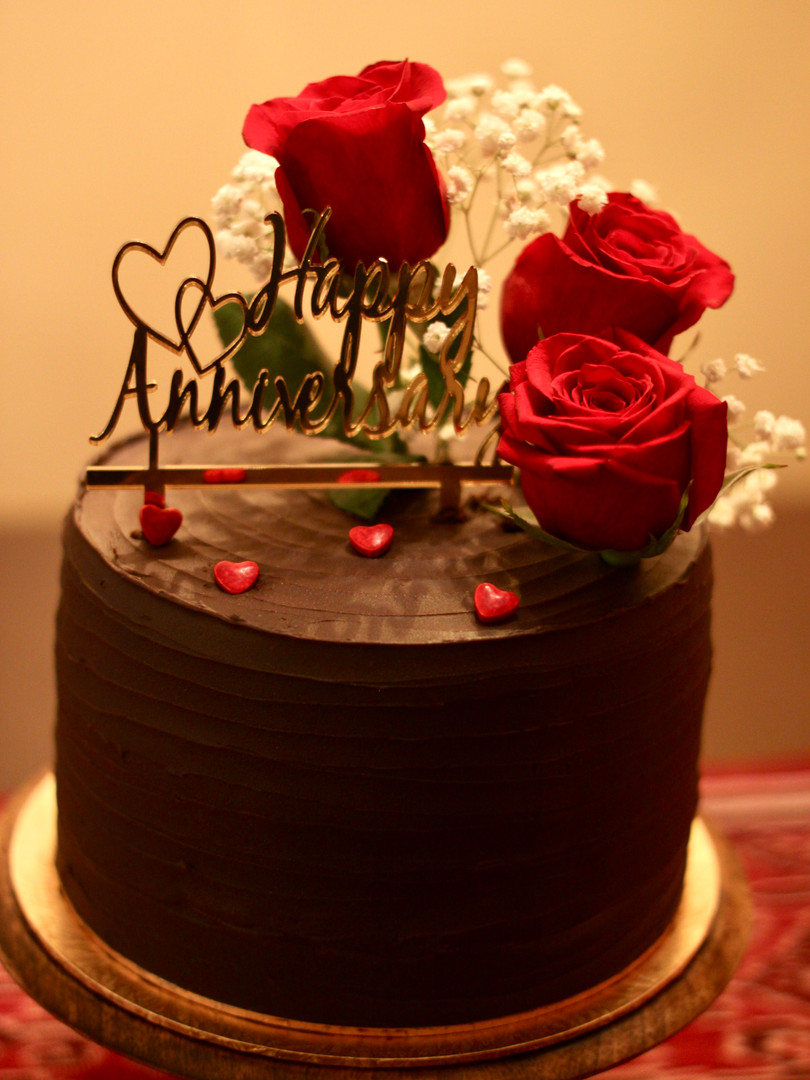 Chocolate cake decorated with fresh flowers