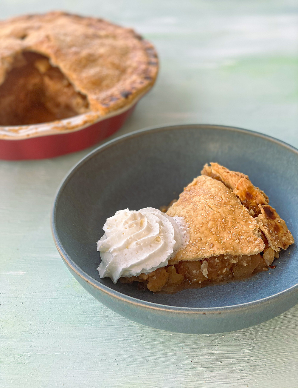 Warm apple pie with whipped cream
