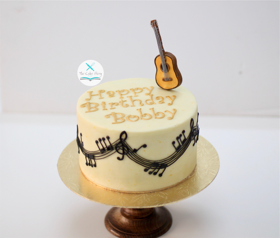 A Lemon and bluberry cake with lemon buttercream for a music lover