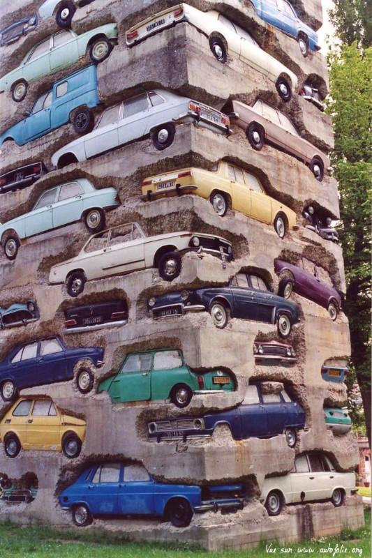 ARMAN Long Term Parking 1982 Dimensions 1950 cm Description Accumulation of 60 automobiles in concrete 19dot5 mdot Parc de sculpture Le Montcel Jouy en Josas France_edited.jpg