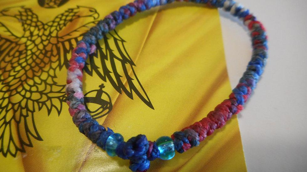 Athos Komboskini bracelet red/white/blue with blue translucent beads