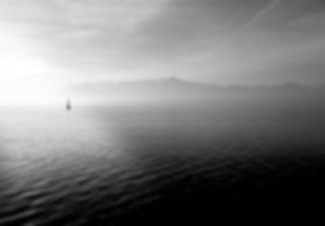 Sailboat on smoky waters