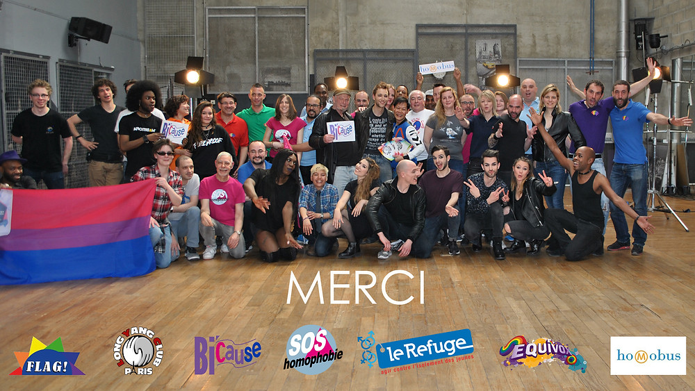 """Christophe Madrolle entouré de plusieurs associations LGBT dans le clip """"We Are""""."""