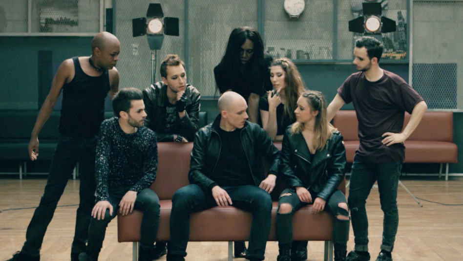 """Christophe Madrolle et ses danseurs dans le clip """"We Are""""."""