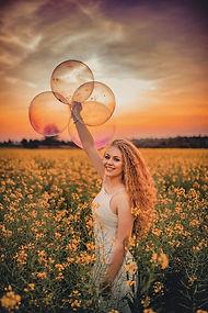joyful woman field.jpeg